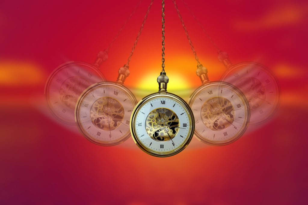 a hypnosis clock swings back and forth to bring you into a relaxed state