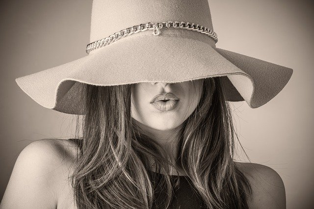 Model wearing a hat covering her eyes